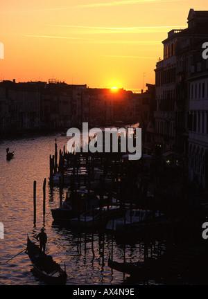 Gondolas on Grand Canal at sunset from Rialto bridge Venezia Venice Veneto Italy - Stock Photo