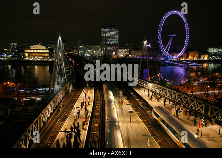 View over Charing Cross Railway Station andHungerford Bridge towards Royal Festival Hall and London Eye, South Bank, - Stock Photo
