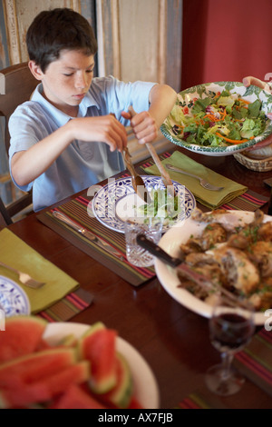 High angle view of a boy sitting at a dining table - Stock Photo