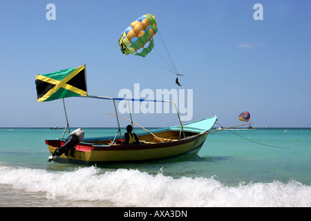 small boat Seven Mile Beach Negril Jamaica - Stock Photo