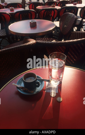 Table with a cup of espresso and a glass of water in a bistro, Karl Johaentges, Paris, France - Stock Photo