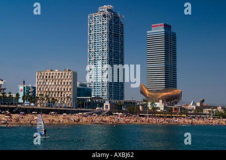 ESP Spain Barcelona beach Platja de la Barceloneta Hotels Arts skulpture by Frank Gehry Passeig Maritim Promenade - Stock Photo