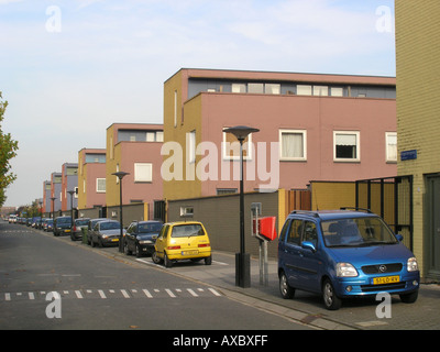 Row of identical terraced houses in modern architecture Almere Buiten Netherlands - Stock Photo