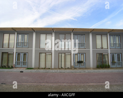Row of identical terraced houses in modern architecture Almere Netherlands - Stock Photo