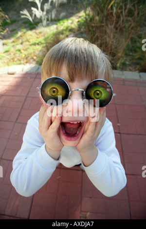 Stock photo of a child wearing holographic glasses with eyes. Silly, funny humor and surprise concepts - Stock Photo