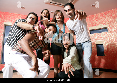 Teenage friends enjoying in a bar - Stock Photo