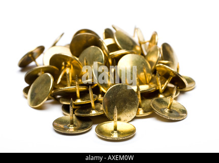 Pile of gold drawing pins on white background cut out silo - Stock Photo