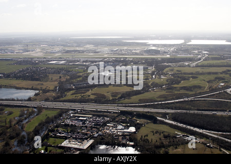High level oblique aerial view east of Heathrow Airport M4 Motorway Hillingdon London TW6 England UK Feb 2006 - Stock Photo