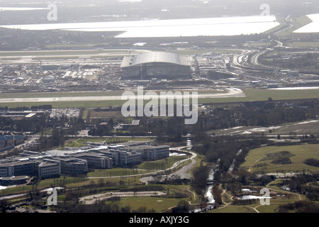 High level oblique aerial view east of Heathrow Airport Terminal 4 T4 construction site Hillingdon London TW6 England - Stock Photo