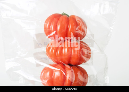 Heirloom tomatoes stacked in plastic bag, close-up - Stock Photo