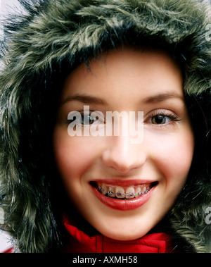 Portrait of a young woman in a winter jacket. - Stockfoto