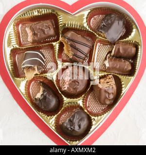 Still life of heart shaped box of chocolates - Stock Photo