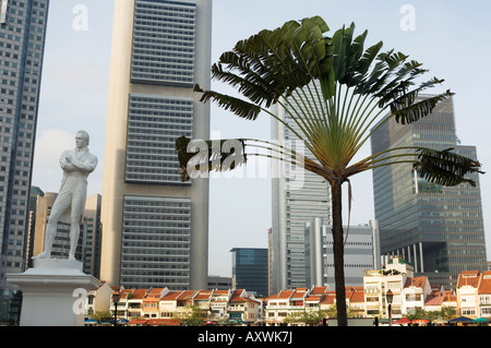 Raffles Landing Site, statue of Sir Stamford Raffles with Boat Quay and the Financial District beyond, Singapore, - Stock Photo