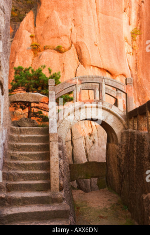 Steps, bridge, and last sunrays on rock face, White Cloud scenic area, Huang Shan (Yellow Mountain), Anhui Province, - Stock Photo