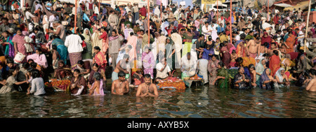 Hindus bathing in the early mornin in the holy river Ganges, Varanasi (Benares), Uttar Pradesh state, India - Stock Photo