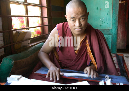 Tibetan monk rolls Buddhist mantras, Ganden Monastery, Tibet Autonomous Region, China. Sept 06. - Stock Photo