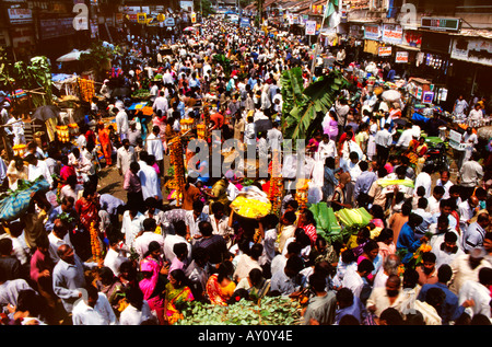 Waves of humanity. Unimaginable buzz of Dadar West Street Market seething with crowds of  buyers and sellers. Mumbai - Stock Photo