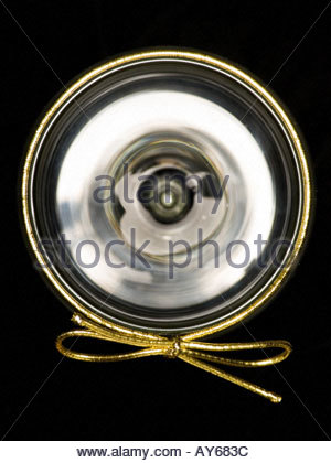 wine glass with a golden gift wrap tie - Stock Photo