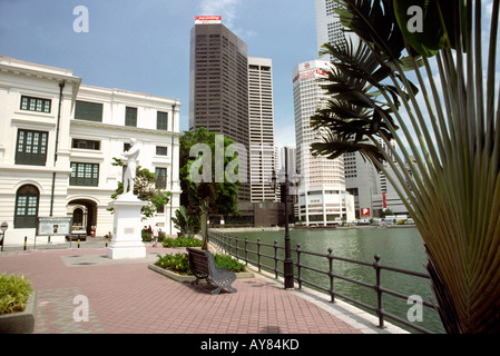 Singapore River and statue of Sir Stamford Raffles at North Boat Quay - Stock Photo