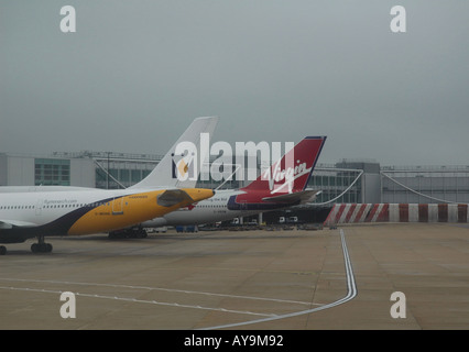 Monarch and Virgin planes on a stand at London Gatwick airport - Stock Photo