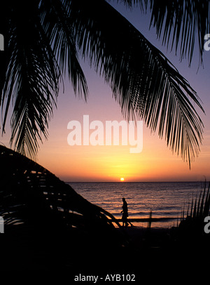 Negril Beach in Jamaica at sunset - Stock Photo