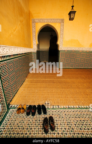 Antiquities Shoes outside the Mosque in the Mausoleum of Moulay Ismail Town of Meknes Morocco - Stock Photo