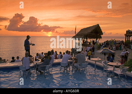 Jamaica Negril Ricks Cafe Open air Pool Bar Viewpoint at Sunset - Stock Photo