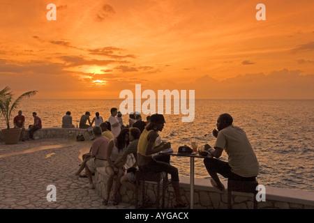 Jamaica Negril Ricks Cafe open air bar viewpoint at sunset - Stock Photo