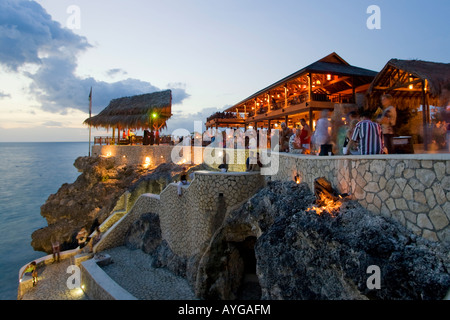 Jamaica Negril Ricks Cafe open air bar viewpoint at sunset - Stock Photo