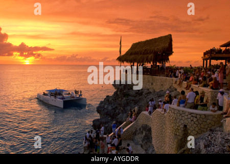 Jamaica Negril Rick s Cafe open air bar viewpoint at sunset - Stock Photo