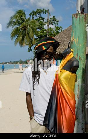 Jamaica Negril beach cool Rastafari man in front of fashion shop - Stock Photo