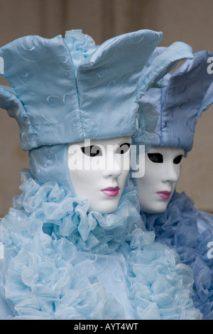 Two people wearing ice-blue costumes and masks, Carnevale di Venezia, Carneval in Venice, Italy - Stock Photo