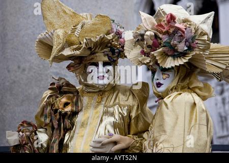 Two golden costumes and masks, Carnevale di Venezia, Carneval in Venice, Italy - Stock Photo