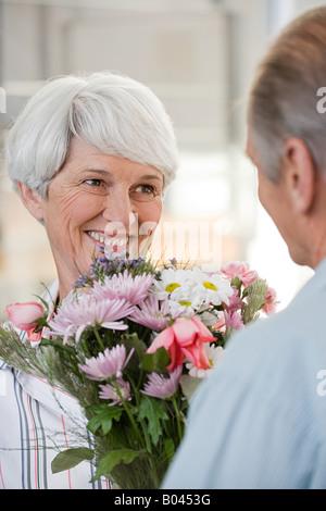 http://n450v.alamy.com/450v/b0453g/a-senior-man-giving-a-senior-woman-flowers-b0453g.jpg