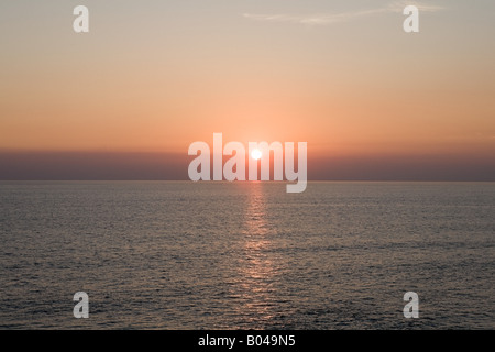 Sunset over the sea - Stock Photo
