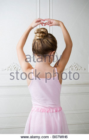Young girl performing a ballet move - Stock Photo