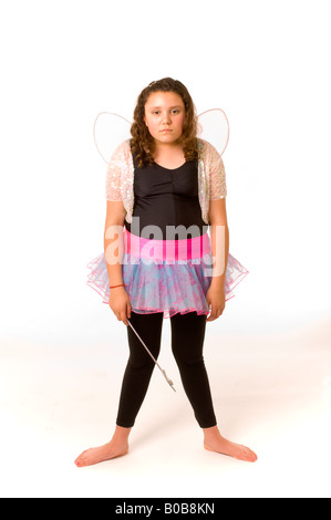 Young girl dressed in fairy outfit on white background looking sad and depressed - Stock Photo