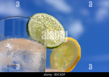 Glasses of water with ice, lemon and lime - Stock Photo