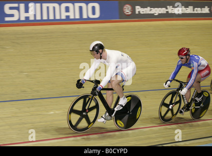 Chris Hoy of Scotland leads Arnaud Tournant France World Champion British sprinter at Manchester Cycling World Championship - Stock Photo