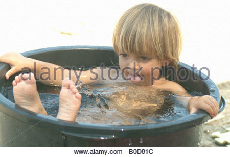 5 Year Old Boy In Bathtub Playing With Toys Stock Photo Royalty Free Image