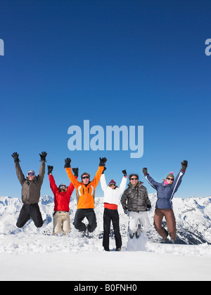 Group jumping in snow - Stockfoto