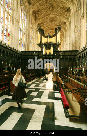 A Tourist admires the inside of the magnificent Kings College Chapel, Cambridge, UK - Stock Photo