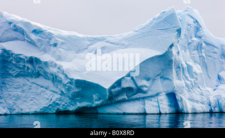 Detailed face of an iceberg in Paradise Bay Antarctica - Stock Photo