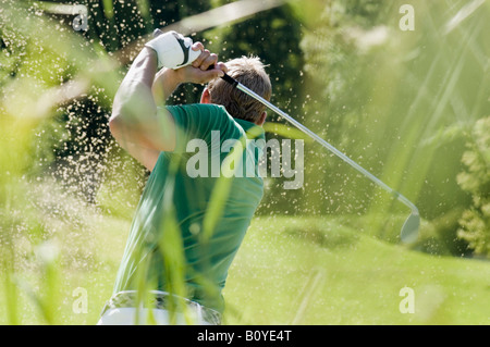 Golf player, rear view - Stock Photo