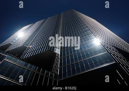 Shiny dark glass office building - Stock Photo