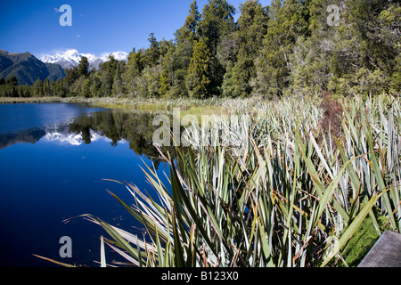 mt cook and mt tasman and their reflection in lake matheson south island new zealand - Stock Photo