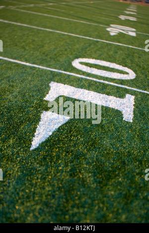 TEN YARD LINE ON AMERICAN FOOTBALL FIELD - Stock Photo