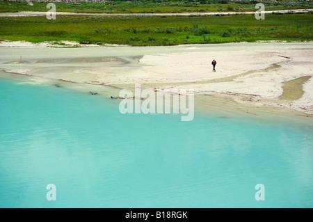 Man hiking on the shore of Lake Louise, Banff National Park, Alberta, Canada. - Stock Photo