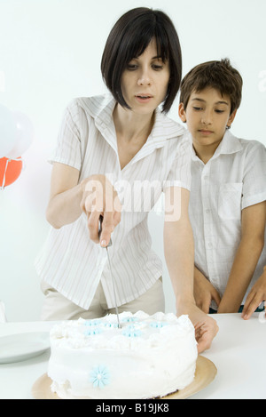 Mom and son cutting a birthday cake together Stock Photo 35632338