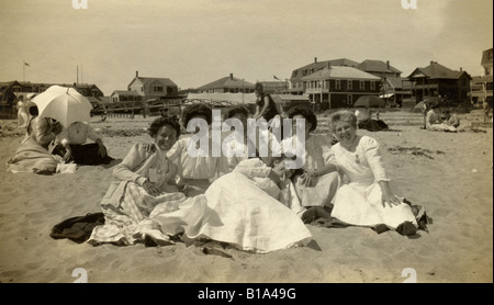 Antique circa 1890s photograph of proper young Victorian women on the beach in coastal New England, United States. - Stock Photo